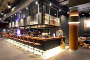 The lounge or bar area at MOXY Denver Cherry Creek