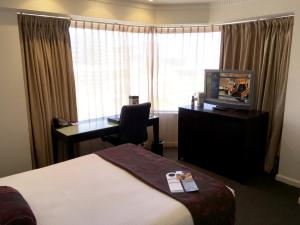 A television and/or entertainment center at Hotel Grand Chancellor Adelaide