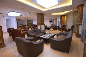 The lounge or bar area at Araliya Green City