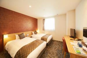 A bed or beds in a room at Sakura Garden Hotel