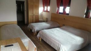 Letto o letti in una camera di Pansion Bijela Ruža