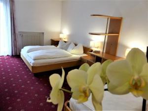 Letto o letti in una camera di Hotel Hubertushof