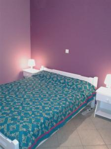 A bed or beds in a room at Vegera Apartments