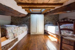 Letto o letti a castello in una camera di Appartamenti turistici Vicolo S. Chiara