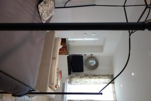 A bed or beds in a room at La Terrasse de Mademoiselle