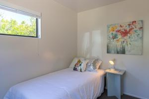 A bed or beds in a room at City Escape - Nelson