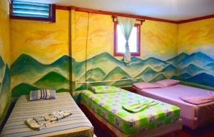 Cama o camas de una habitación en Hospedaje Central