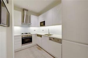 A kitchen or kitchenette at Heart of Knightsbridge - Stunning Air Conditioned Apartment - 1 minute walk from Harrods