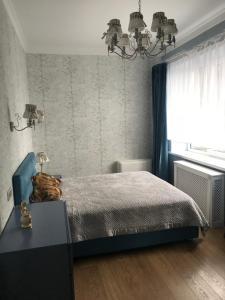 Кровать или кровати в номере Apartment Ideal House Sochi