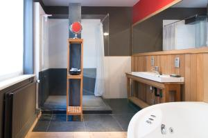 Salle de bains dans l'établissement App De Panne 1