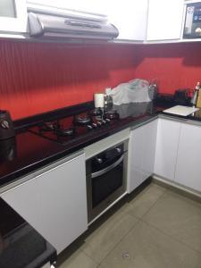 A kitchen or kitchenette at Apartamento Ahj