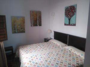 Uma cama ou camas num quarto em El Sueño de Lucrecia