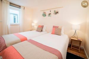 Un ou plusieurs lits dans un hébergement de l'établissement Lis Apartments
