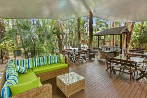 A seating area at The Reef Retreat Palm Cove