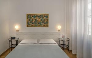 A bed or beds in a room at Hotel Cecile