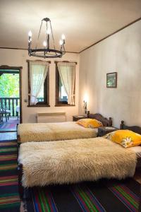 A bed or beds in a room at Milkovata Guest House