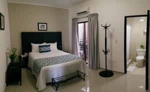 Ein Bett oder Betten in einem Zimmer der Unterkunft Hotel Residence Casa Reyes