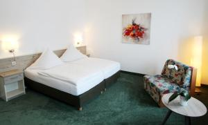 Ein Bett oder Betten in einem Zimmer der Unterkunft Hotel Thormählen