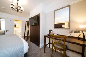 A television and/or entertainment center at Innkeeper's Lodge St Albans, London Colney