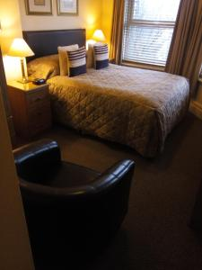 A bed or beds in a room at The Newark