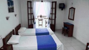 Ένα ή περισσότερα κρεβάτια σε δωμάτιο στο Hotel Selenunda