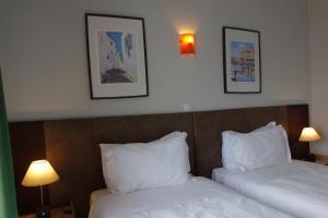 Uma cama ou camas num quarto em Guest House Oliveira