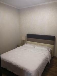 A bed or beds in a room at Graden resort villa