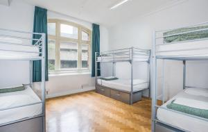 A bunk bed or bunk beds in a room at Base Sydney