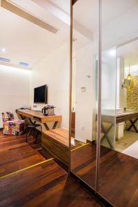 A television and/or entertainment center at The Daulat (SG Clean, Staycation Approved)