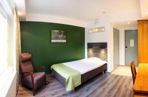 Un ou plusieurs lits dans un hébergement de l'établissement Finlandia Hotel Airport Oulu