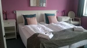 En eller flere senge i et værelse på Fjordhotel Augustenborg
