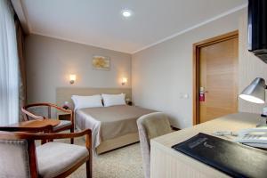 Кровать или кровати в номере Бишкек Бутик Отель