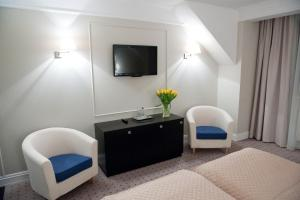 A television and/or entertainment center at Hotel Focus