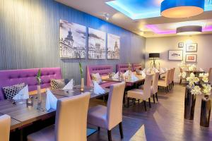 A restaurant or other place to eat at Leonardo Royal Hotel Warsaw