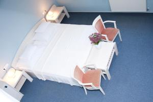 A bed or beds in a room at Abbazia Country Club superior