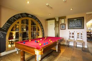 A pool table at The Woolpack Inn