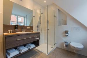 Ein Badezimmer in der Unterkunft Hotel am Schrannenplatz
