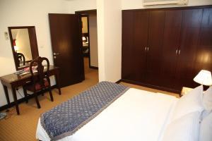 سرير أو أسرّة في غرفة في توليب إن الرياض
