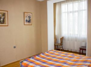 Кровать или кровати в номере Baku Boulevard