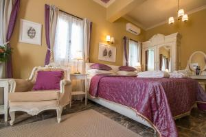 A bed or beds in a room at Symi Nautilus Luxury Suites