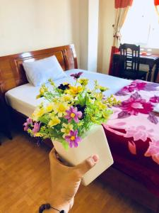 A bed or beds in a room at Star Binh Duong Hotel