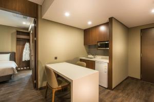 A kitchen or kitchenette at ENA Suite Hotel Namdaemun