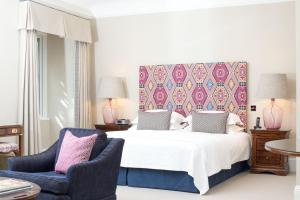 A bed or beds in a room at Longueville Manor