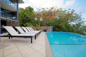 The swimming pool at or near at Waterfront Whitsunday Retreat - Adults Only