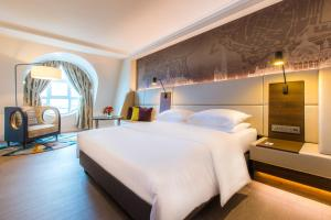 A bed or beds in a room at Radisson BLU Astrid Hotel, Antwerp