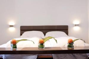 A bed or beds in a room at 12 Months Luxury Resort