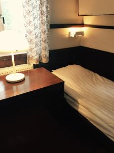 A bed or beds in a room at Rättviksgården