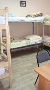 A bunk bed or bunk beds in a room at Hostel Saratov House