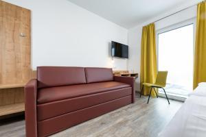 Ein Sitzbereich in der Unterkunft Cleverhotel