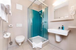Ein Badezimmer in der Unterkunft Cleverhotel